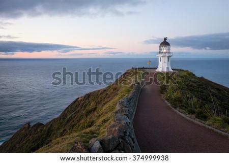 Cape Reinga lighthouse at dusk, New Zealand - stock photo