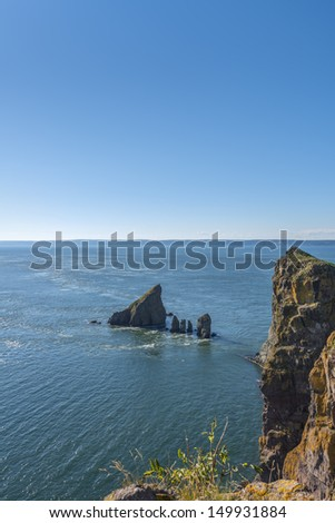Cape Split cliffs and tidal current (Nova Scotia, Canada) - stock photo