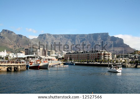 Cape Town Harbour overlooked by Table Mountain (South Africa) - stock photo