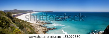 Cape Town - panoramic aerial view of surfers at beautiful Noordhoek Beach - stock photo