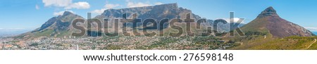 CAPE TOWN, SOUTH AFRICA - DECEMBER 18, 2014: Panoramic view of part of the city, Devils Peak, Table Mountain, Twelve Apostles and Lions Head. The lower and upper cable stations are visible.