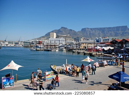 CAPE TOWN, SOUTH AFRICA - DECEMBER 30, 2007: Victoria and Alfred Waterfront, harbor with recreation boats, shops, restaurants and Table Mountain on background in Cape Town, South Africa.
