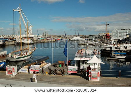 CAPE TOWN, SOUTH AFRICA - FEBRUARY 20, 2012: Victoria and Alfred Waterfront, harbor with boats, shops and restaurants popular with tourists.