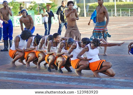 CAPE TOWN - SOUTH AFRICA - MAY 25 : Unidentified young men and women wears workers clothing, during presentation of soweto street dancing, south african style on May 25, Cape Town, South Africa. - stock photo