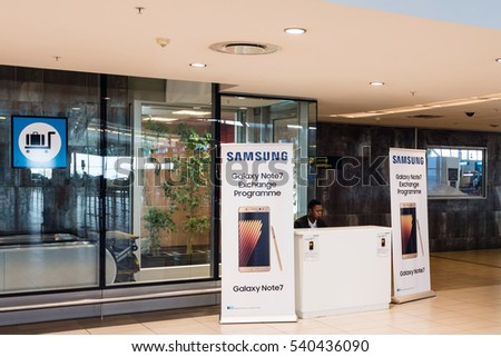 Cape Town, South Africa - November 24, 2016: A booth for exchanging the Samsung Galaxy Note 7 at the airport of Cape Town: Since the smart phone is facing problems with its battery that might explode