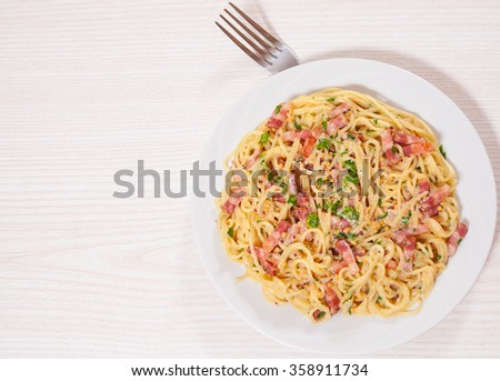 capellini pasta and sauce with bacon