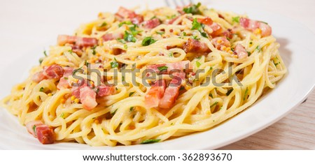 capellini pasta and sauce with bacon - stock photo