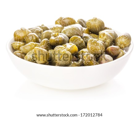 Capers in white bowl isolated on white background - stock photo