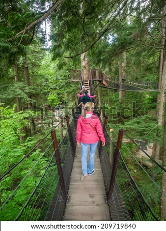 Capilano Suspension Bridge is a simple suspension bridge crossing the Capilano River in the District of North Vancouver, British Columbia, Canada. - stock photo