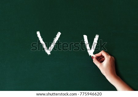 Capital and lowercase letter V on chalkboard, blackboard texture. Chalk Alphabet. Concept of education or back to school on green background