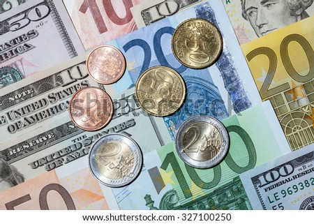 Capital augmentation: euro and dollar banknotes and euro coins - stock photo