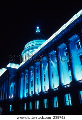 capital building illuminated at night with blue lights