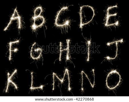 Capital letters A to O written in sparkler trails, other letters numbers and symbols available separately - stock photo