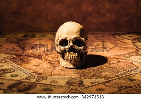 Capitalism concept : Skull on bank note and vintage map background.