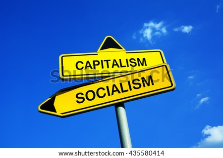 Capitalism or Socialism - Traffic sign with two options - socialist centralized economic planning or capitalist liberated free market  - stock photo