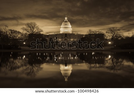 Capitol Building with mirror reflection in water - Washington DC - Sepia