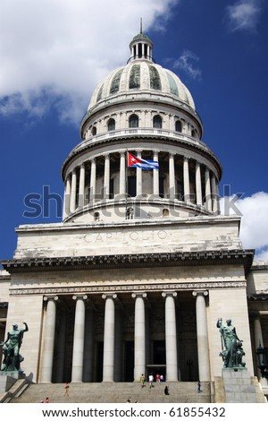 capitol of Cuba with the cuban flag in La Havana on a summer day.