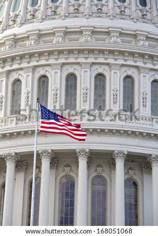 Capitol with American flag - detail, US, Washington DC  - stock photo