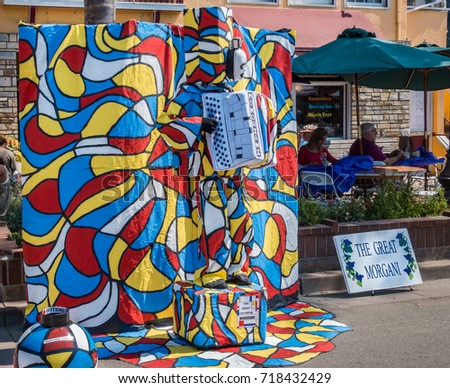 Capitola, California - September 10, 2017: The Great Morgani, a musical street artist, performs at the Capitola Wine and Art Festival.