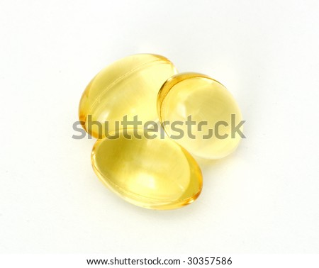 Caplets with fish oil - stock photo