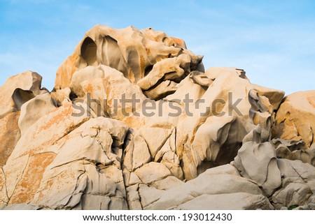Capo Testa rock formations at sunset in Santa Teresa di Gallura, Sardinia, Italy - stock photo