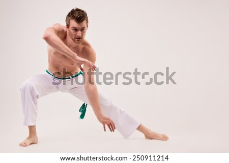 Capoeira dancer on white background - stock photo