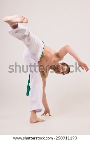 Capoeira guy making a coup - stock photo