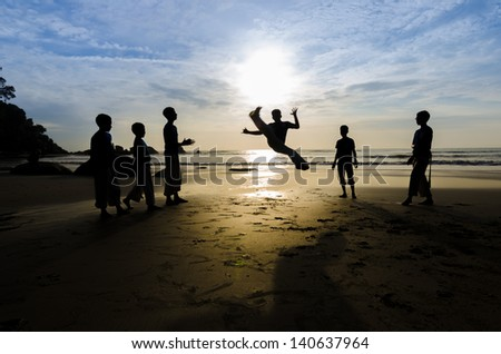 Capoeira Roda near the beach by Capoeirasta - stock photo