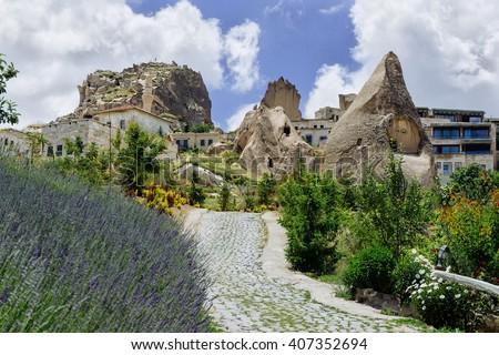 Cappadocia Goreme. Rural view of Cappadocia. Cappadocia landscape. Stone houses of Cappadocia.Sunny Goreme Cappadocia. Cappadocia houses made in mountains with lavender field. Cappadocia mountains. - stock photo