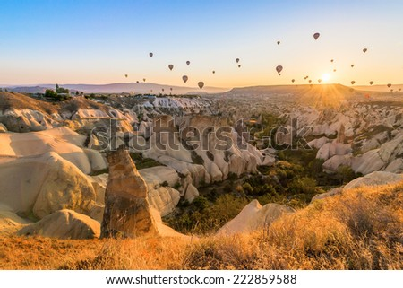 CAPPADOCIA, TURKEY - CIRCAR JUNE 2014 : Hot air balloons fly over Cappadocia, recognised as UNESCO world heritage, in circa June 2014 in Cappadocia, Turkey.