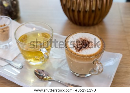 Cappuccino coffee cup and tea,Hot coffee in white mug,hot tea - stock photo