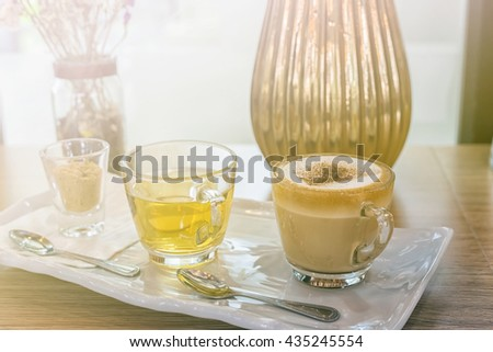 Cappuccino coffee cup and tea,Hot coffee in white mug,hot tea. Filled color filter. - stock photo
