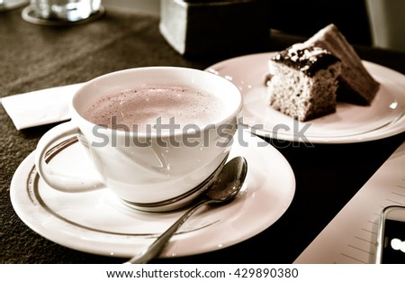 Cappuccino coffee in a white cup - stock photo