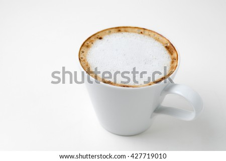 cappuccino coffee in cup isolated on white