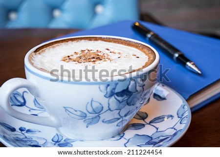 Cappuccino coffee  on the table  - stock photo