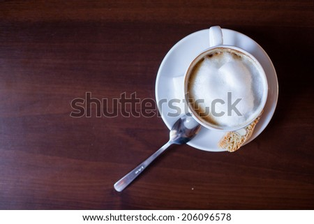 Cappuccino Coffee on wooden table background. - stock photo