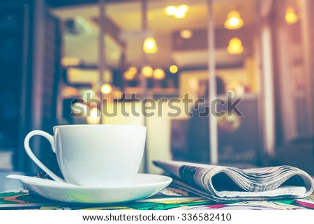 Cappuccino coffee with blur coffee shop background, vintage tone  - stock photo