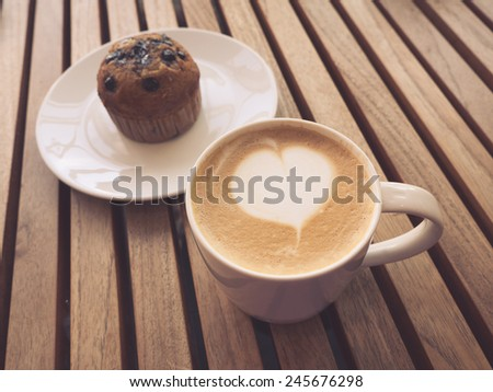 Cappuccino coffee with retro vintage style filter effect - stock photo