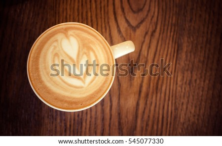 cappuccino cup on the brown wooden table