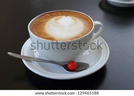 Cappuccino cup with drawing