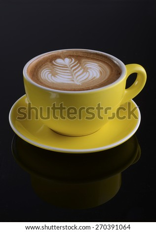 Cappuccino cup with drawing on foam - stock photo