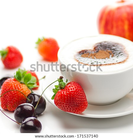 cappuccino in a cup in the shape of hearts,cherry,croissant  and strawberries isolated on white - stock photo