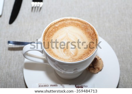 cappuccino in a white cup on a table