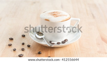 Cappuccino or latte coffee in cup with frothed on table - stock photo