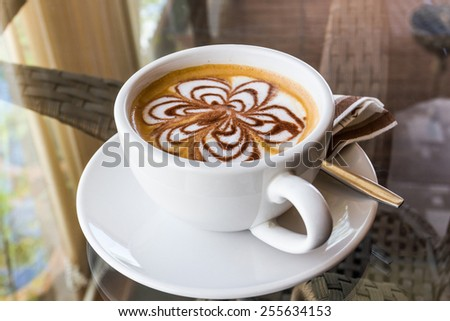 Cappuccino or latte coffee with flower shape.