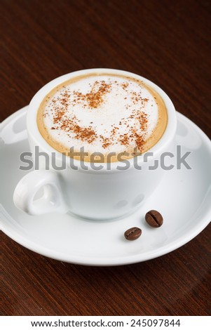 Cappuccino or latte coffee with heart - stock photo