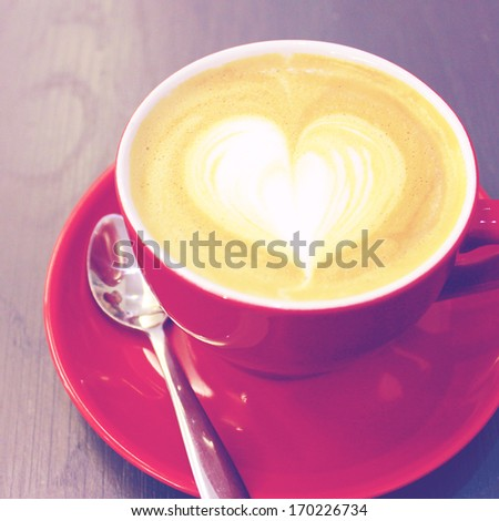 Cappuccino or latte coffee with heart shape, retro filter effect - stock photo