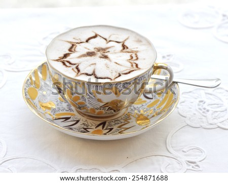 Cappuccino with an ornament in a cup - stock photo