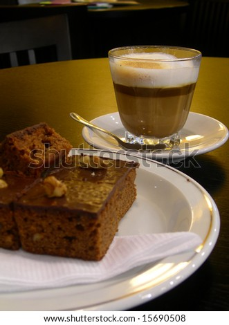 Cappuccino with chocolate brownie - stock photo