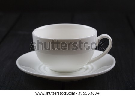 Cappuccino with cinnamon in a white cup. Coffee on Black Wooden Table